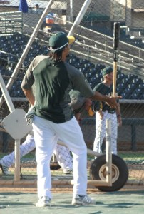 Coco Crisp performing his amazing one-handed bat-balancing act