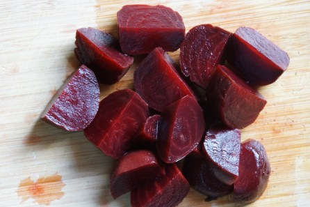 Quarter the cooked beets and slice into thin half moons.