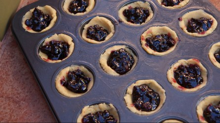 Combine lemon zest and juice, dried fruit and preserves until well blended. Spoon ½ teaspoon into each muffin cup.