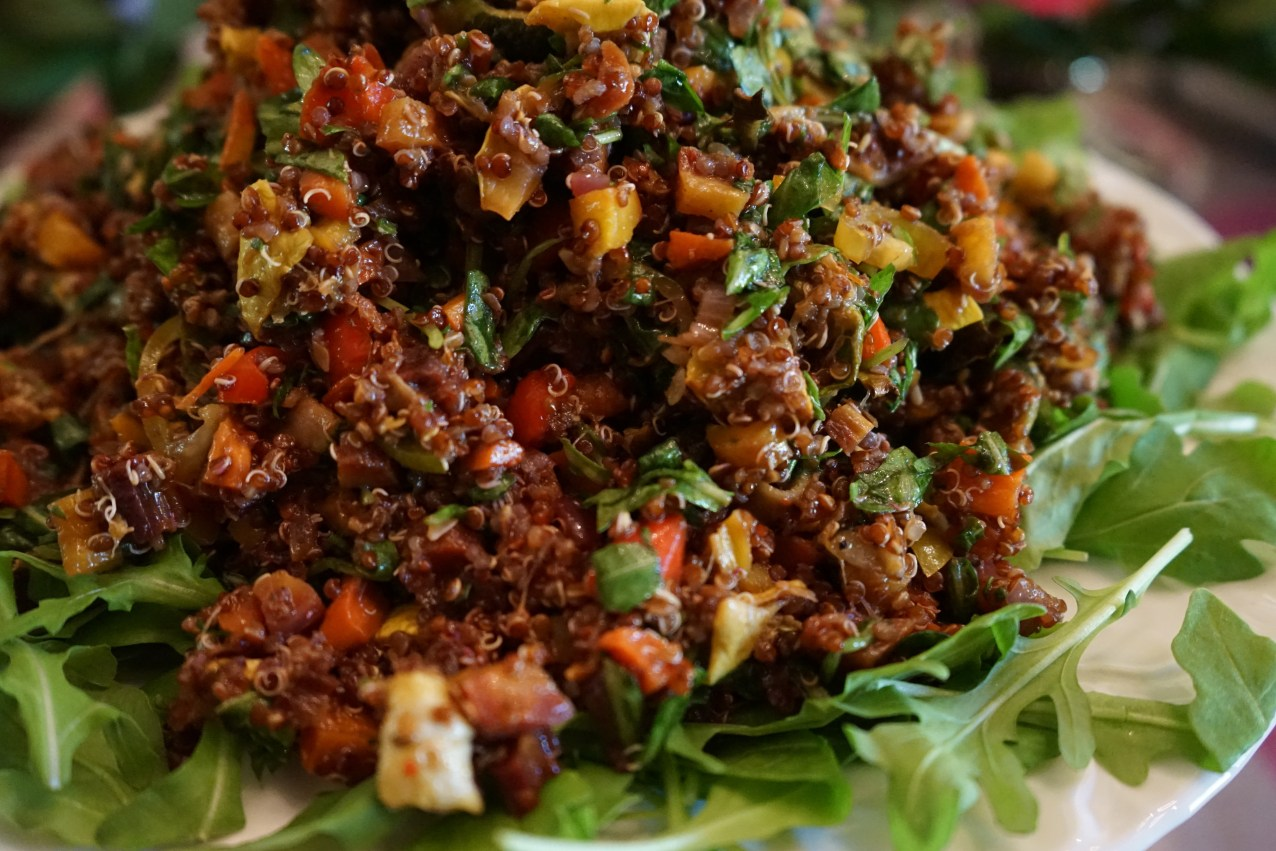 Add quinoa, cherry tomatoes, torn arugula and homemade dressing to the vegetables, and toss.