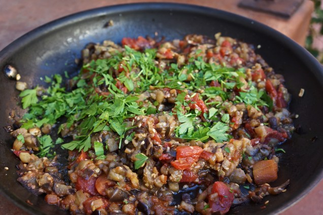 Cook eggplant until it starts to brown. Add diced tomatoes, fresh basil, salt and pepper. Combine until thoroughly mixed. Cook about 3-5 minutes. Add Italian parsley.