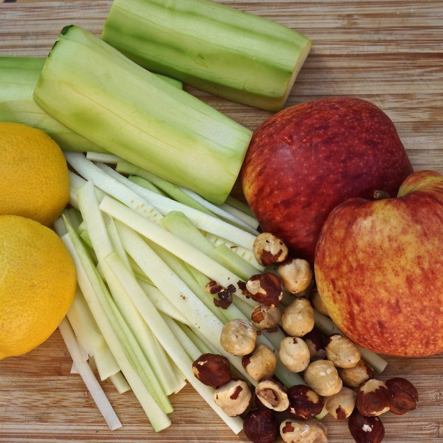 Peel zucchini and slice into matchsticks and add to bowl with apples and lemon juice.
