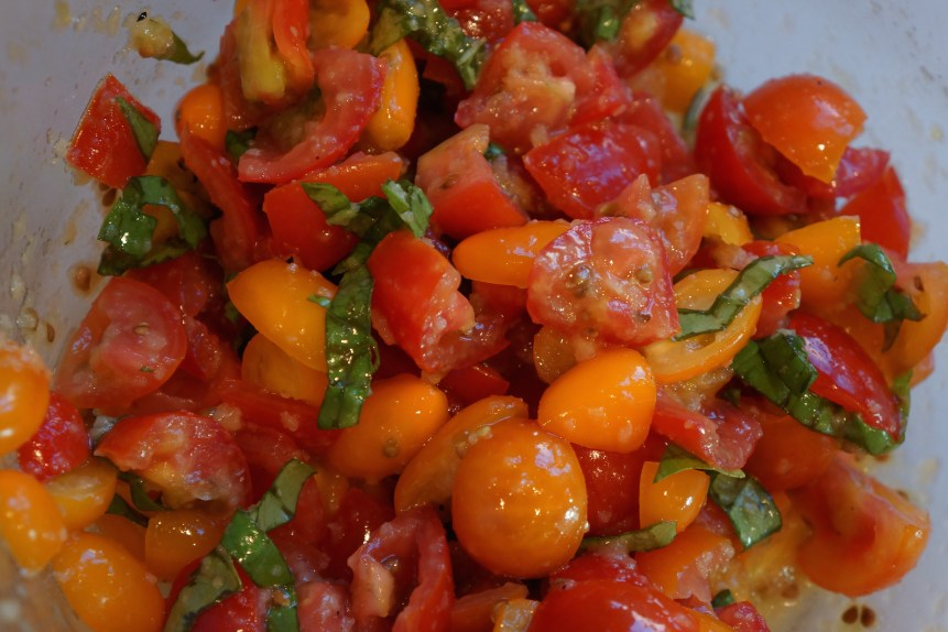 Either the day before or while pastry is baking, cut up tomatoes and toss with olive oil, garlic and salt. Set aside.