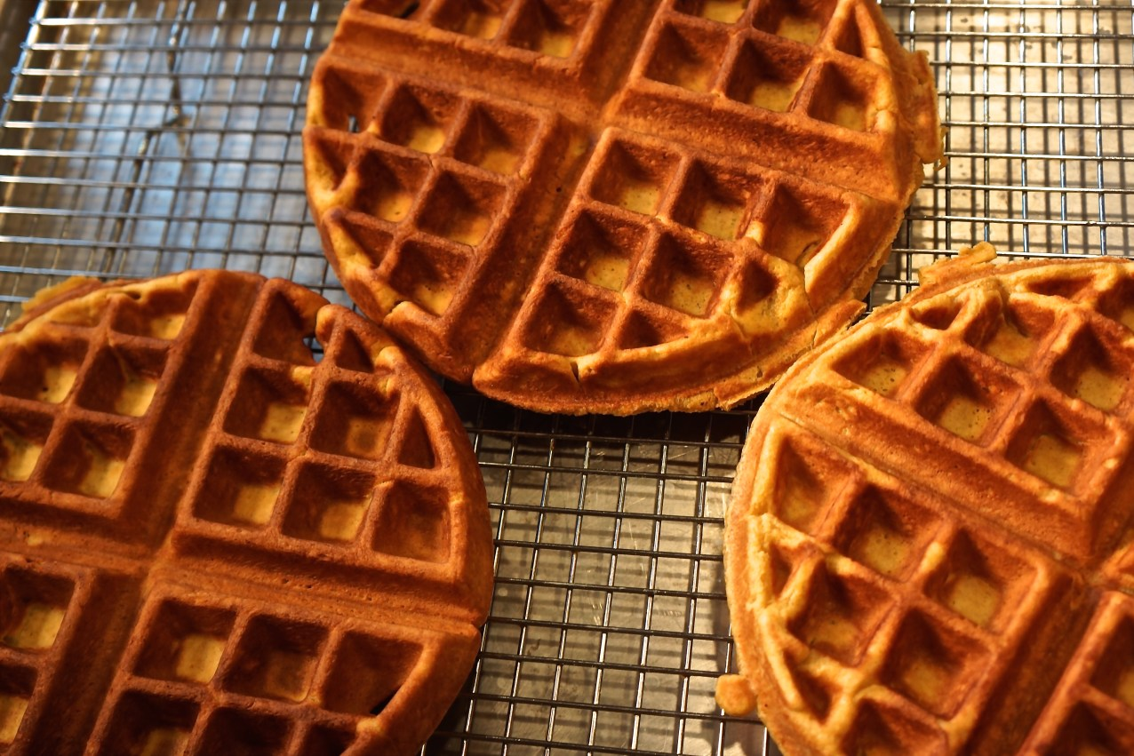 I make them first thing in the morning and keep them warm in a 200 degree oven with the waffles placed on a wire rack, in a baking sheet.