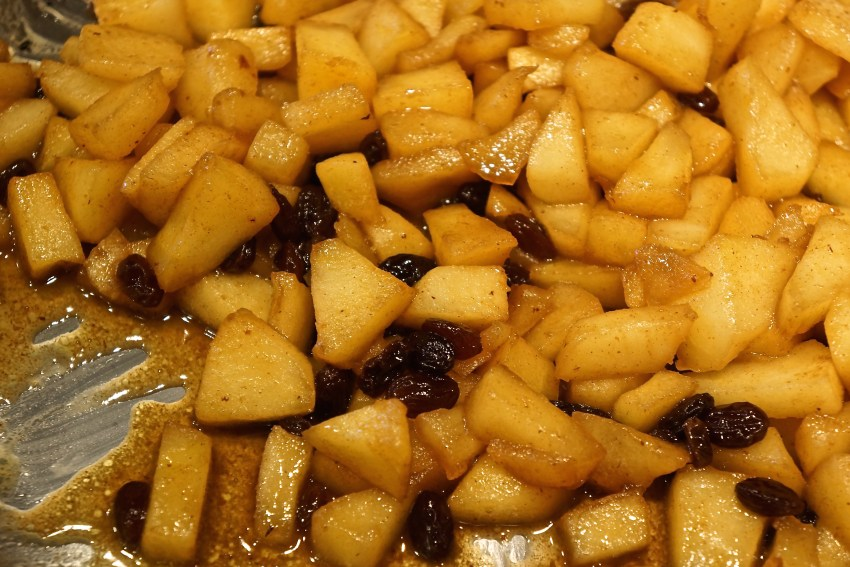 In a large saute pan, saute the apples in melted butter with the sugar, lemon juice, cinnamon, nutmeg and raisins.