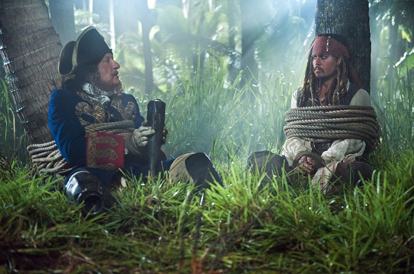 """""""PIRATES OF THE CARIBBEAN: ON STRANGER TIDES""""  Imprisoned by the Spanish, Barbossa (GEOFFREY RUSH) tells Captain Jack Sparrow (JOHNNY DEPP) the dramatic tale of how he lost his leg in an encounter with Blackbeard (Ian McShane).  Ph: Peter Mountain  ©Disney Enterprises, Inc. All Rights Reserved."""