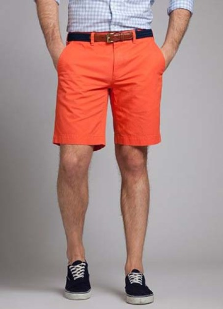 A great combination of solids and patterns: orange pants with a checkered blue shirt!