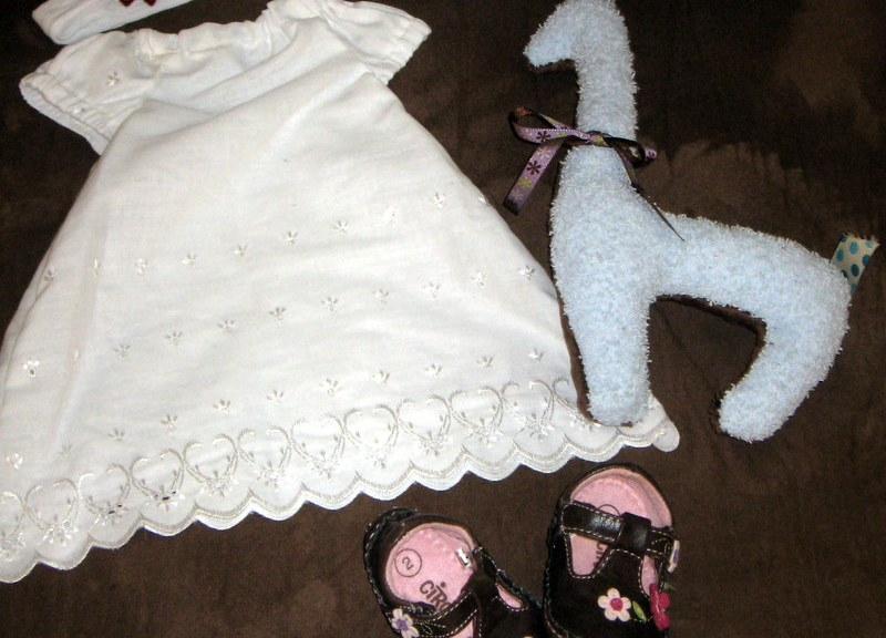 The dress, headband, and giraffe were made by me while the shoes were a wonderful find.