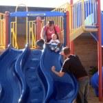Noel's sister Vanessa helping Cooper go down the slide.