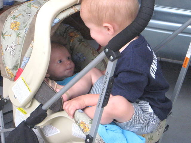 We went for a walk around the block and halfway home Cooper tripped and decided he didn't want to walk anymore. I didn't want to carry him and push the stroller, so I let him perch on the edge of Ellen's car seat. They both seemed quite content with the arrangement.