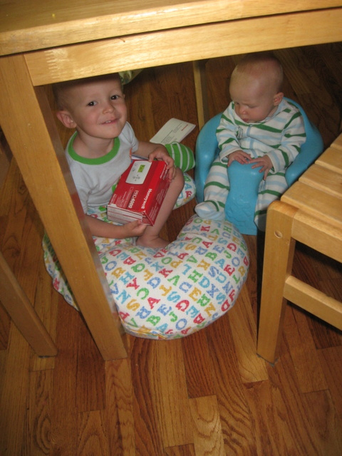 I put Ellen in her Bumbo so I could make breakfast and when I turned around found that Cooper had pulled her under the table. The two of them were chatting away about the thermostat manual.