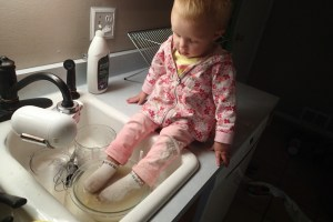 Ellen soaking her feet in the dirty dishes . . .