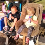 Kids eating breakfast in their car seats.