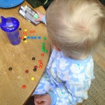 Organizing her M&Ms by color.