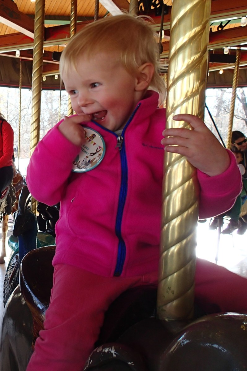Ellen got to ride on the carousel for free since it was her birthday. We were afraid it would freak her out, but she loved it.
