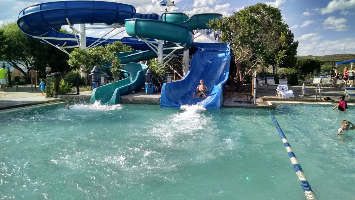 Cooper LOVES the water slide. He'll go down it again and again until his lips are purple.
