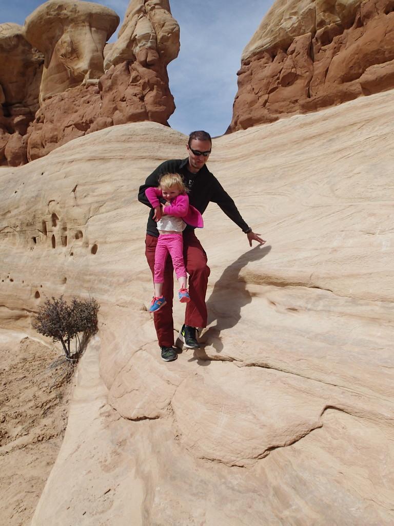 Noel assisting Ellen off a rock.