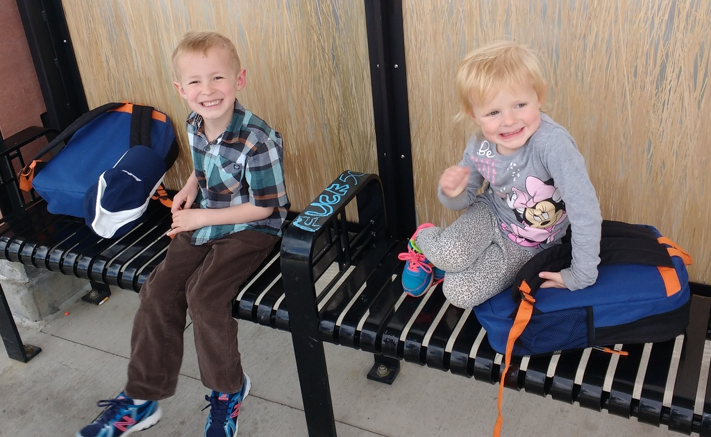 The kids excited to begin our journey at the train station. Blissfully, unaware of the graffiti.