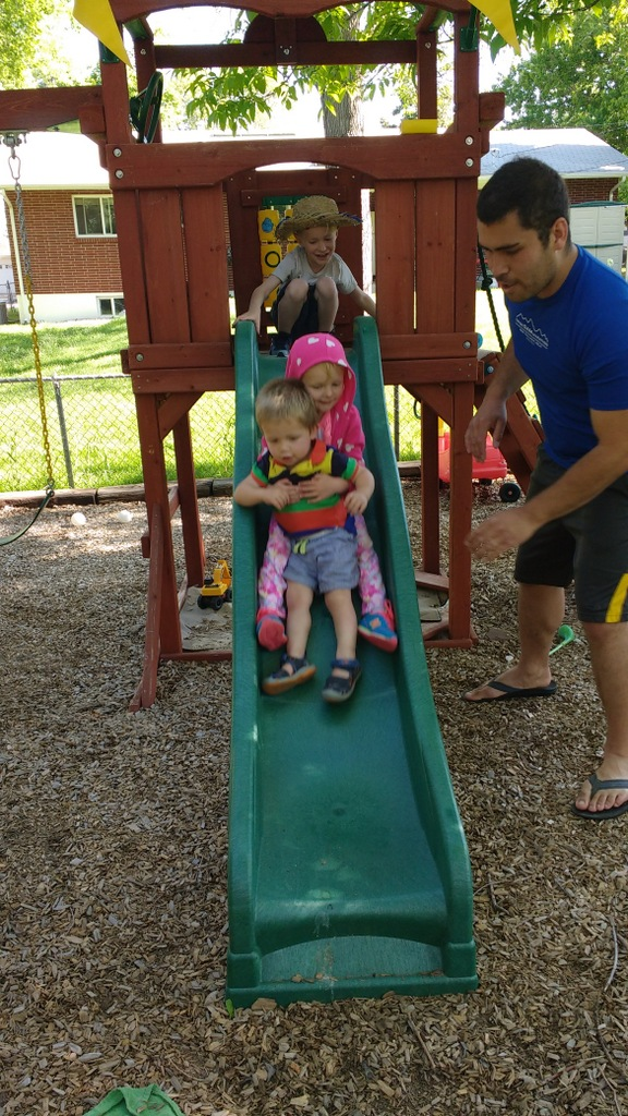 More cousin fun on the slide.
