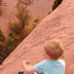 Cooper looking down on our campsite at Arches.