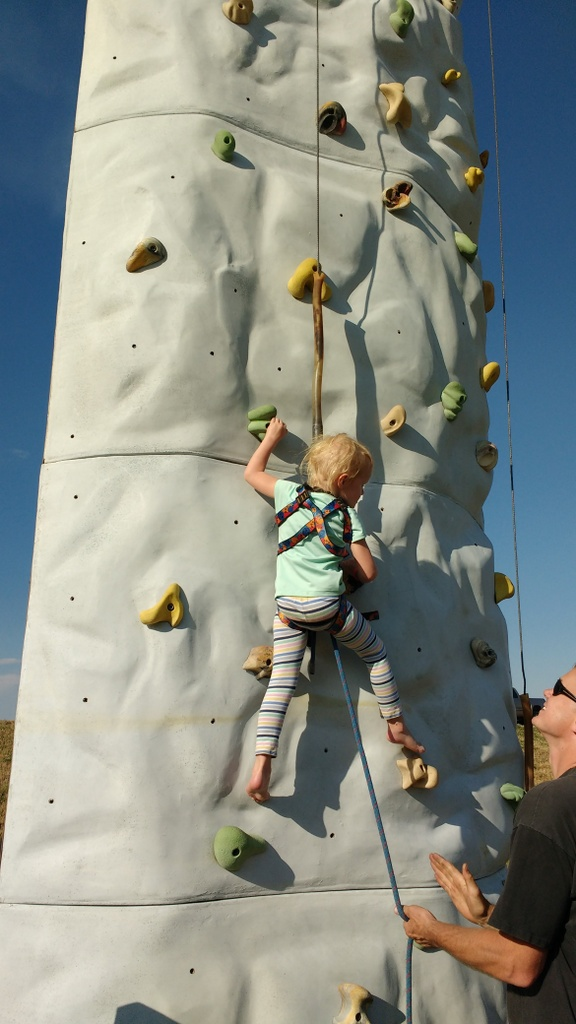 The kids got to climb a climbing wall.