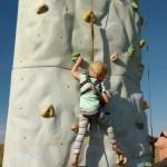 The kids got to climb a climbing wall.