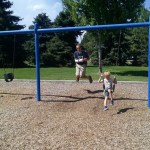 Noel and Cooper swinging at the park.