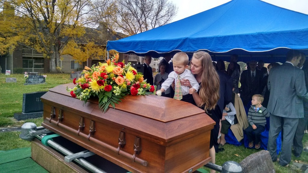 Porter and my sister Hope (his mom) laying flowers on the casket.