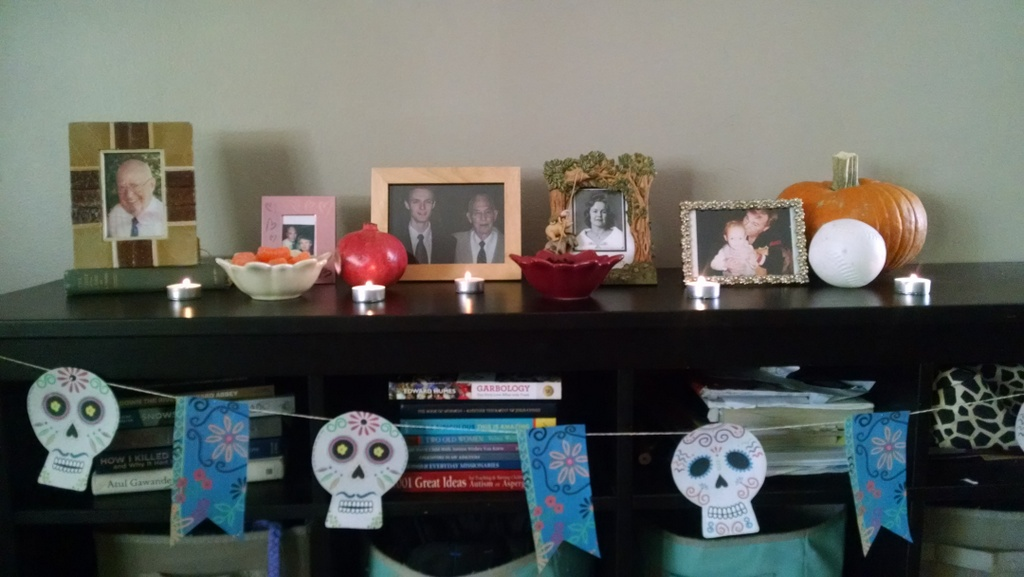 This year we did a Day of the Dead (Dia de los Muertes) altar. I took a lot of Spanish classes in the past and loved the altar Noel's cousin had at her house last year. It was a fun way to teach our kids about some of our loved ones.