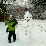 Our awesome snowman, complete with snow hat.