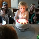 Ellen blowing out the candles.