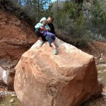 Sarah helped Ellen climb this rock. They're going to be good friends.