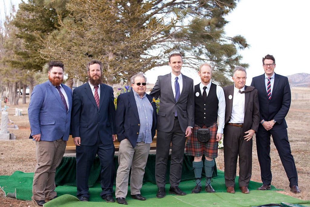 All the men. Pallbearers and bagpiper.