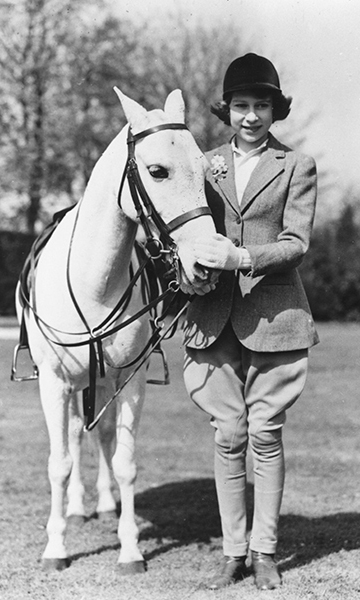 Princess Elizabeth proudly wearing her proper riding attire on her 13th birthday in April, 1939. Image Source: Getty Images.