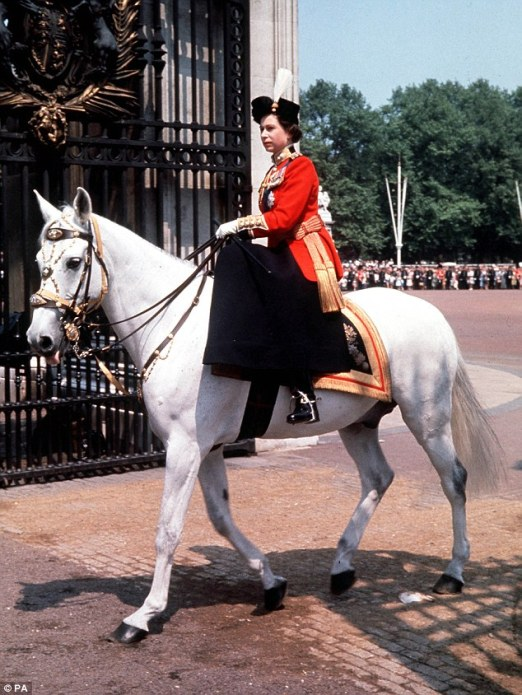 Riding side-saddle, Queen Elizabeth returns to Buckingham Palace, London, after attending the Trooping the Colour ceremony on Horse Guards Parade. Image Source: DailyMail.co.uk.