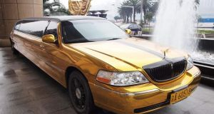 Gold plated Lincoln Town Car stretched Limousine