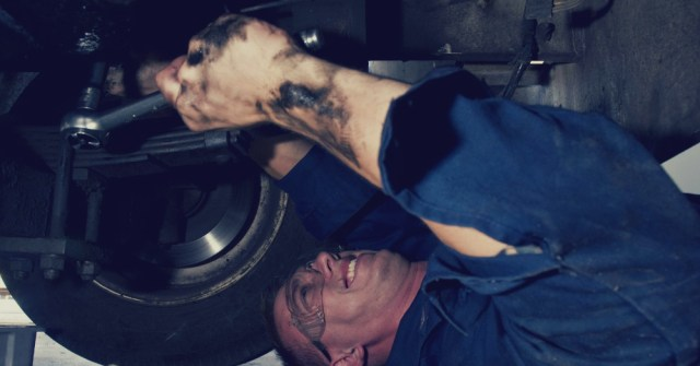01.18.17 - Car Mechanic Changing Oil