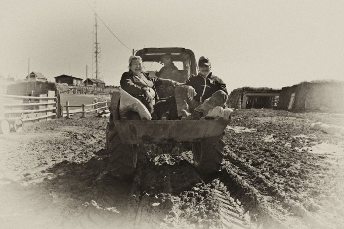 In the tractor's scoop across Siberia. Photo © Galya Morrell