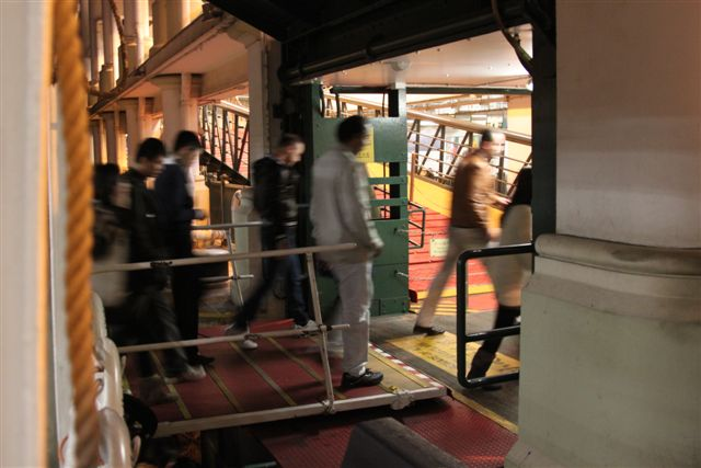 People Walking Off of Hong Kong Star Ferry