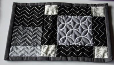 gray and black mug rug 1