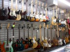 A wall of guitars at A&V Pawn Shop.