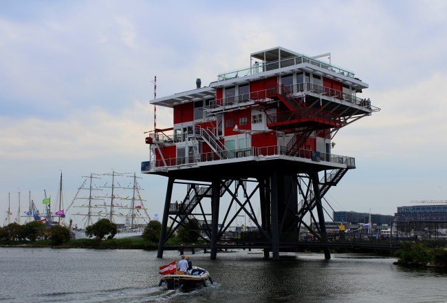 Dine 22 meters above the IJ in an old pirate television tower at REM Eiland restaurant Amsterdam