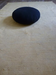 A meditation cushion (zafu). I use mine on top of a soft mat to make it easier on my feet.