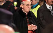 29th March 2013, Colosseum Square, Rome: A praying cardinal is walking through the crowd during the Stations of the Cross chaired by the Pope Francis I around the coliseum on Good Friday. Candles are lit.