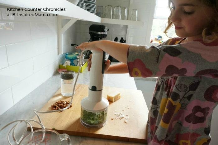 Chopping Basil for A Basil Pesto Kids Recipe at B-Inspired Mama