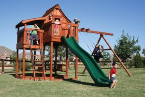 Play Set shown with Mustang 7', Fun Deck 7', Half Shack 6', Deck Ladder 6', Upper Cabin w/ Gable & Eave Doors, Picnic Table (Built-In), 4 Position Swing Beam w/ Cantilever, Ship's Bell, Binoculars, Glider, 2 Belt Swings, Air Pogo, Rave Slide