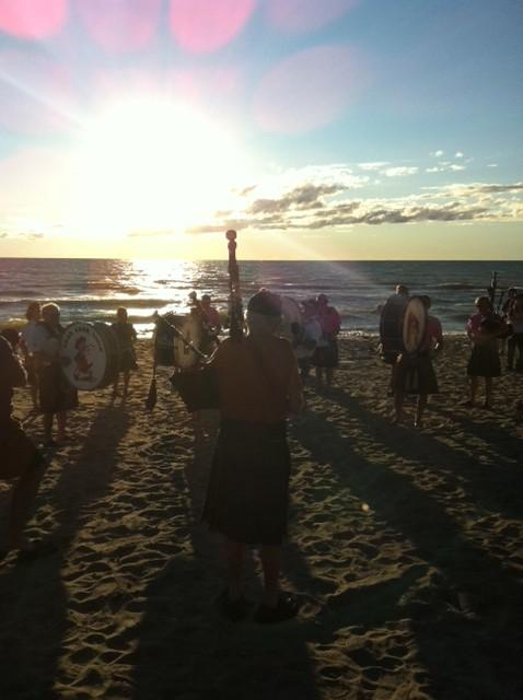 Piping down the sun, Port Albert
