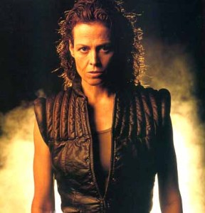Sigourney Weaver as Ellen Ripley, staring challengingly into the camera.