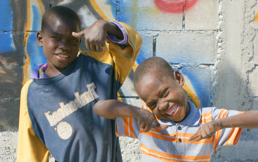 Children in a Haitian slum showing off their Western-taught 'gangsta' moves. (Photo courtesy of the author.)