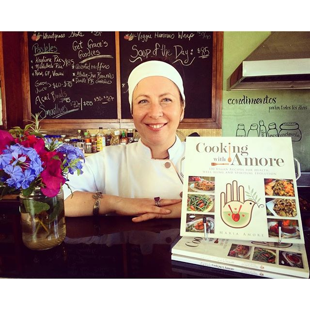 Maria Amore with her Vegan Cookbook, Cooking with Amore